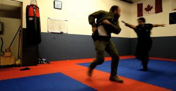 Raw footage of firearms expert vs. elite knife fighter