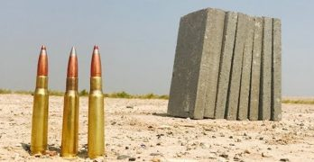 How much concrete does it take to stop a .50 BMG?