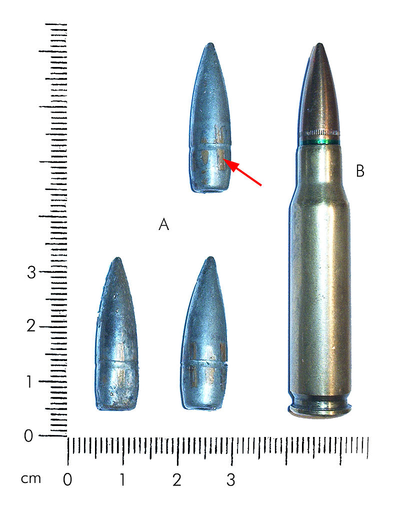 Three recovered 7.62mm caliber bullets compared against a 7.62x51mm NATO cartridge.